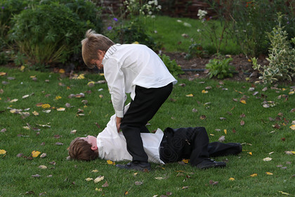 7813455602_4_wedding-two-boys-grass-fun.jpg