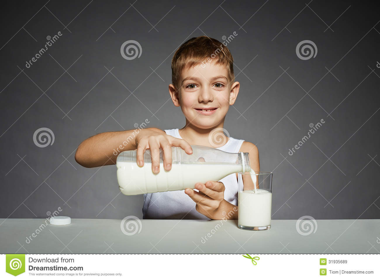 boy-pouring-milk-glass-smiling-31935689.jpg